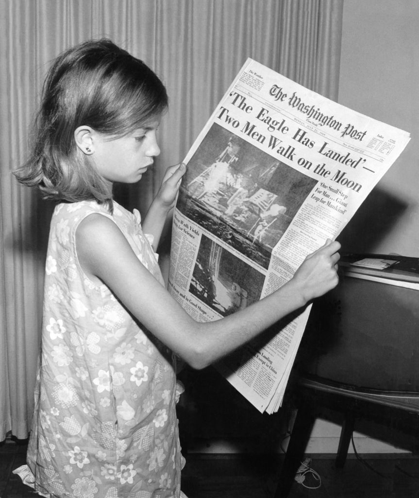 Young Girl Reading Old Newspaper – Old Newspaper WordPress Theme