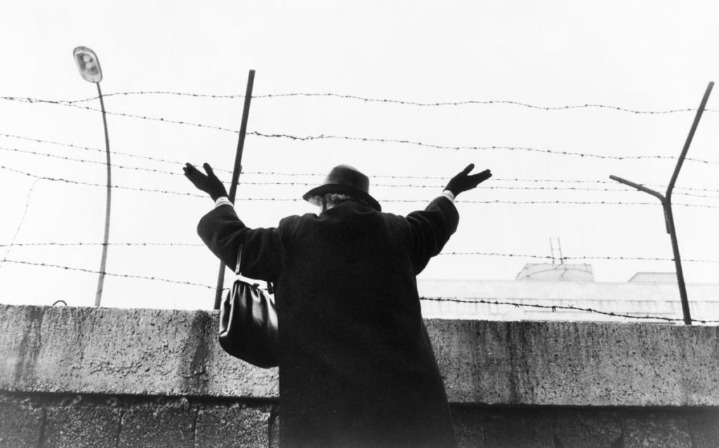 Woman Waving Across the Berlin Wall